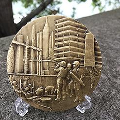 creation médaille construction Batiment